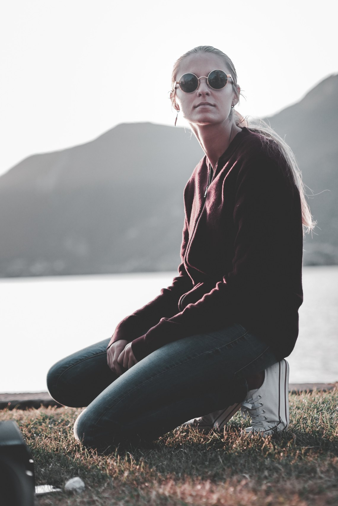 woman kneeling in front of mountains