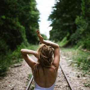 girl around the train tracks