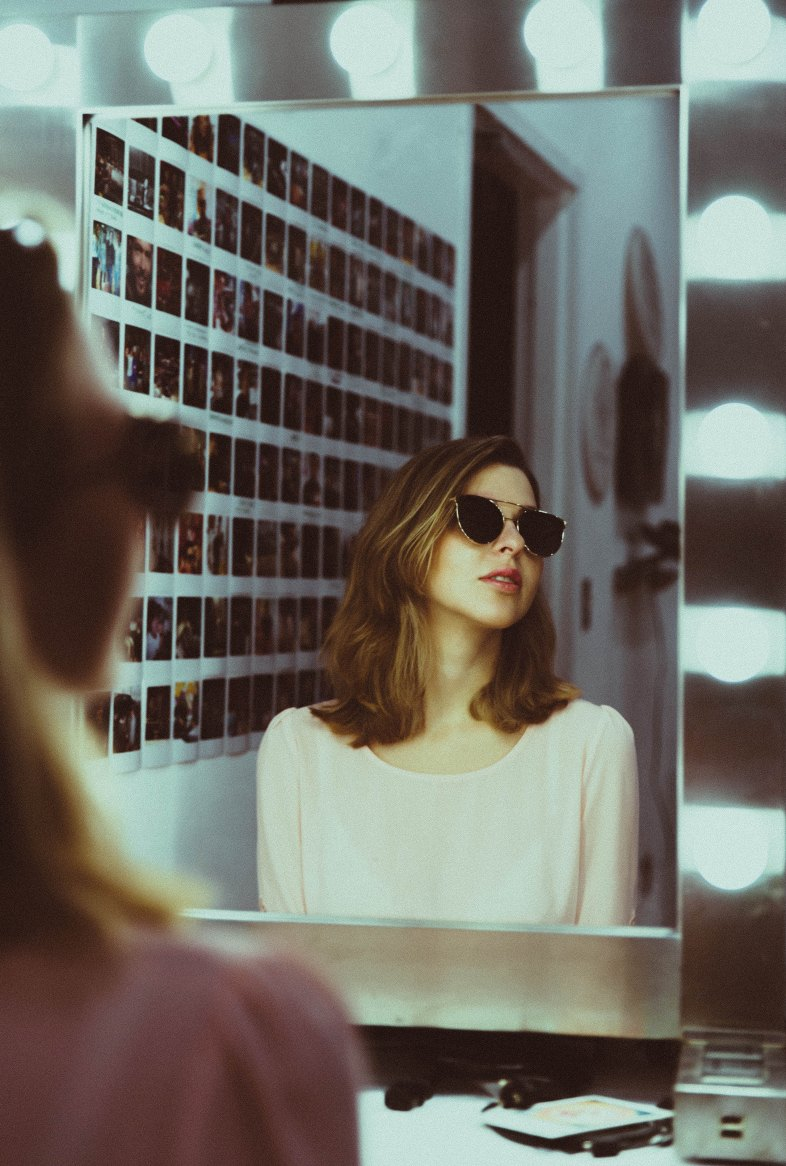 girl reflection in a mirror wearing sunglasses