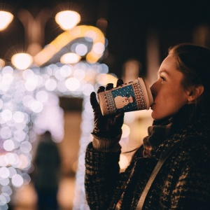 girl drinking coffee at christmas time