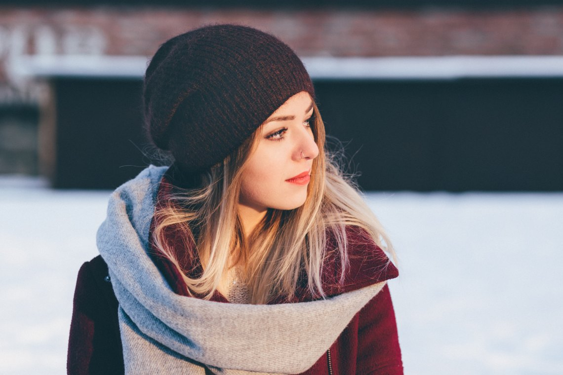 girl in a hat in the snow