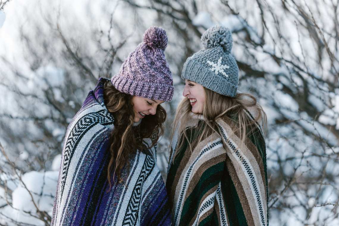 sisters laughing in blankets