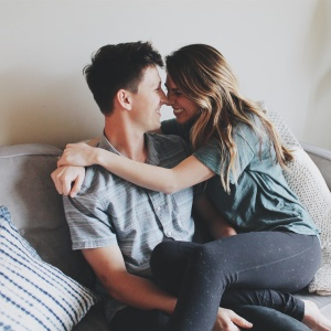 Couple hugging on couch