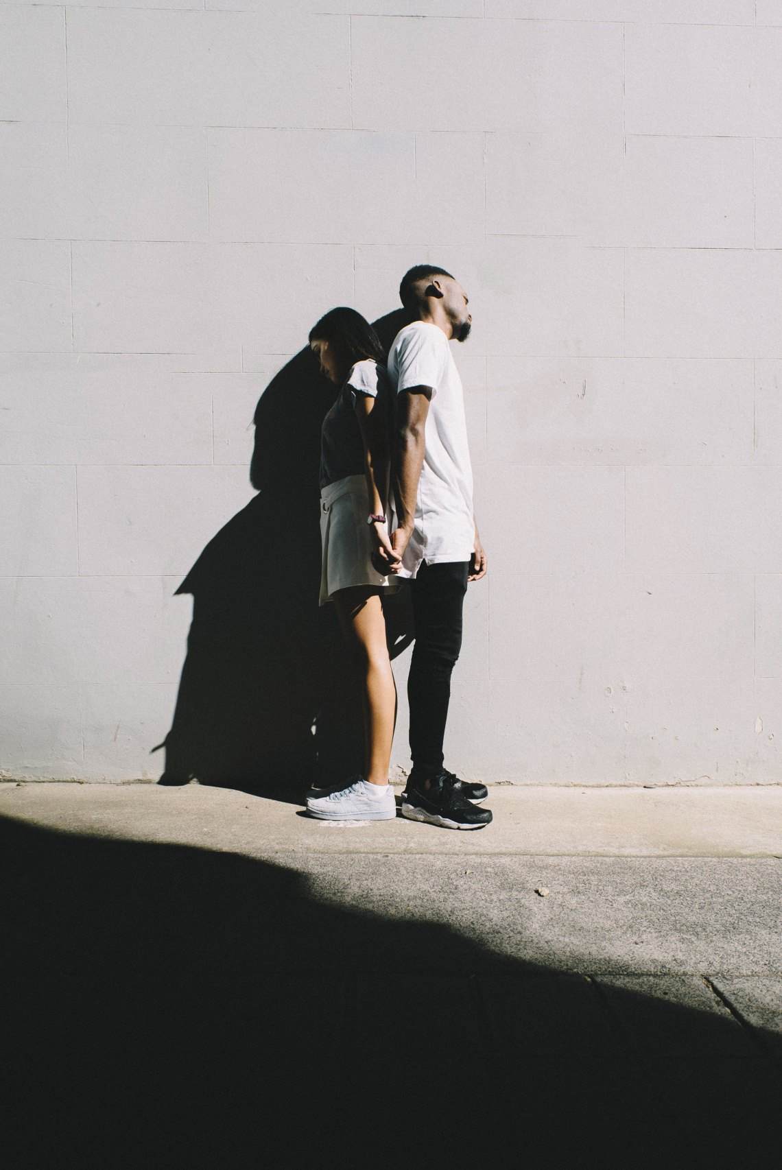 couple standing back to back