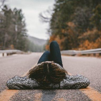 woman laying in street