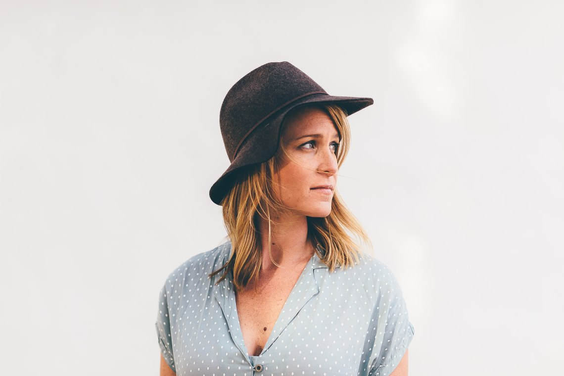 woman in hat looking to side