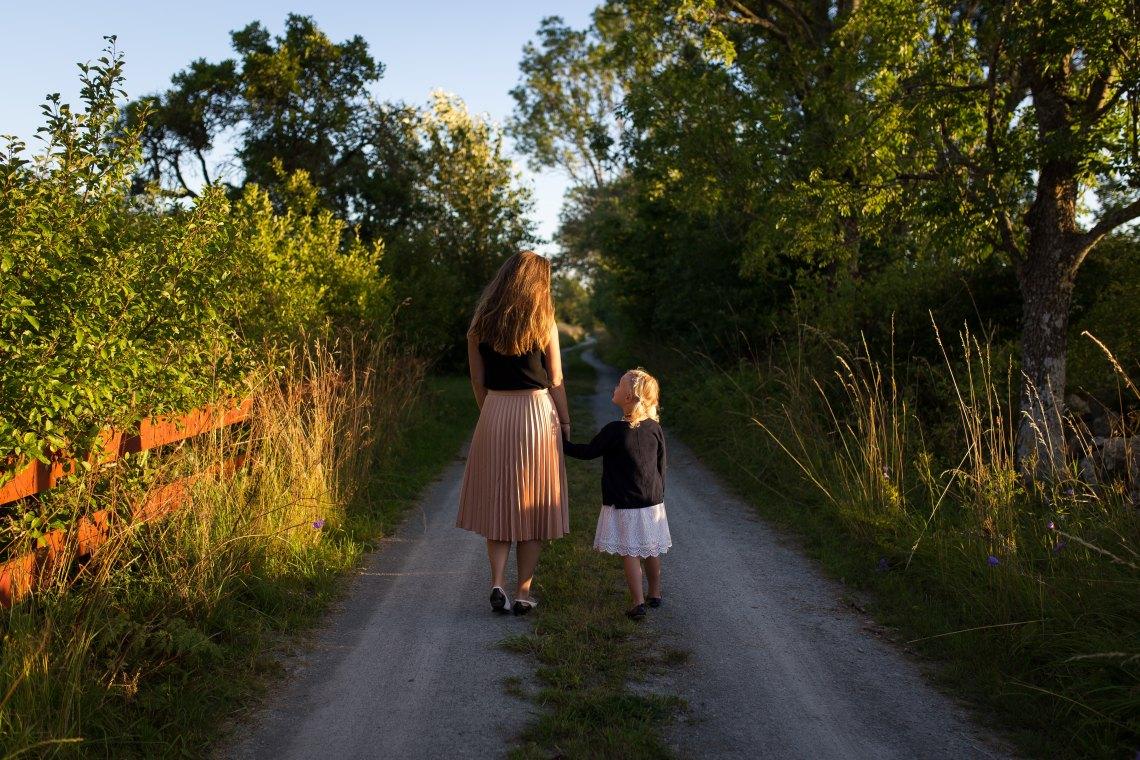 mother daughter walking hand in hand