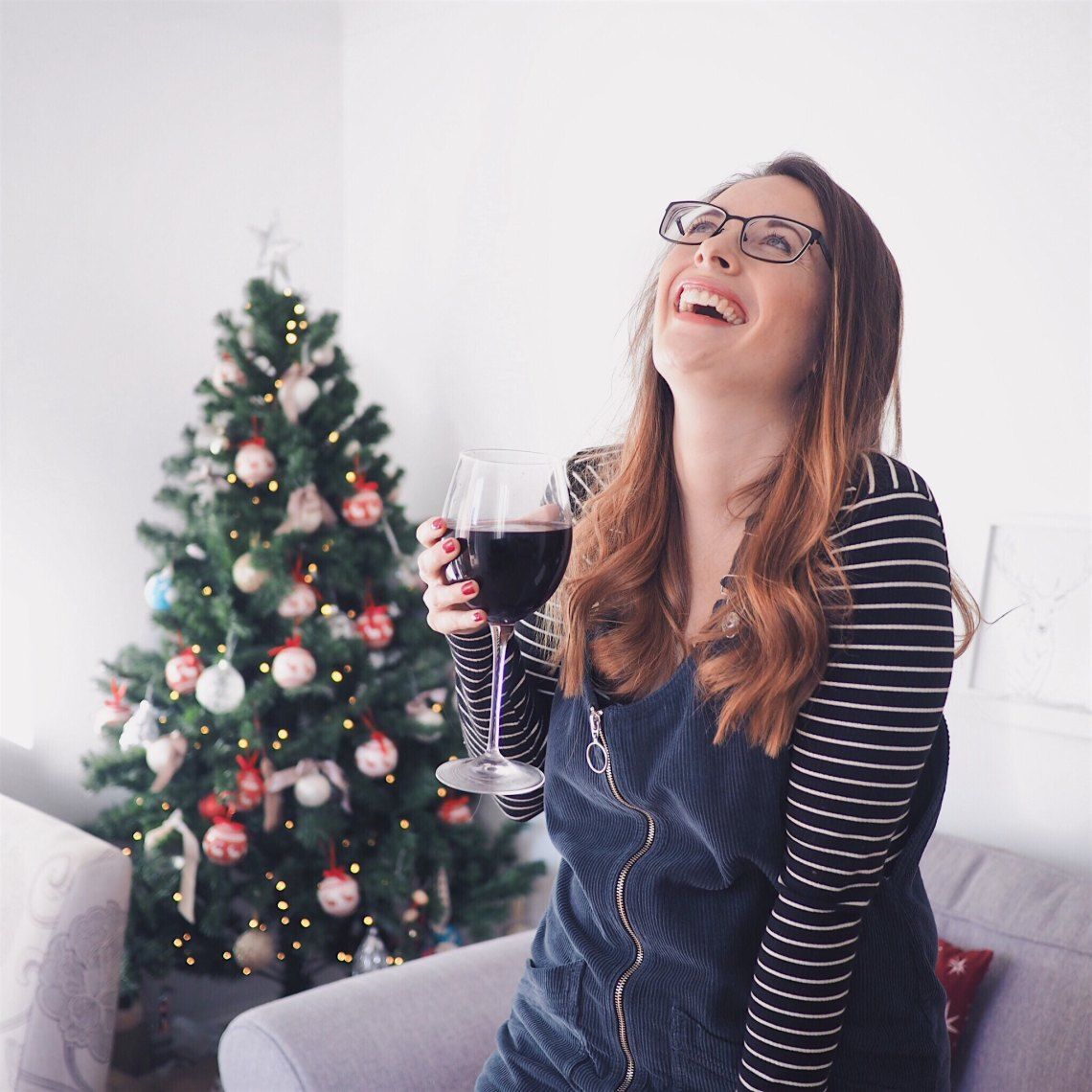 laughing with a christmas tree