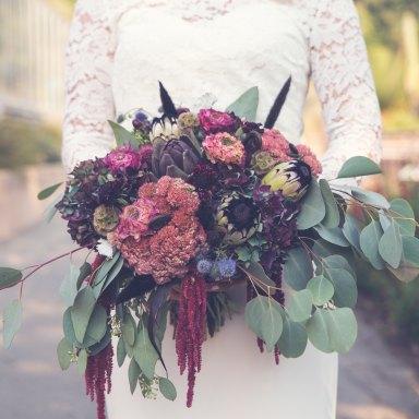 bride holding a massive bouquet