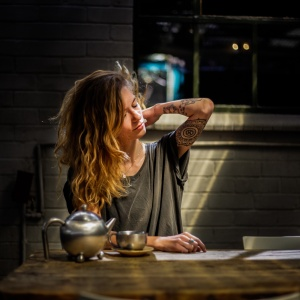 woman sitting drinking coffee