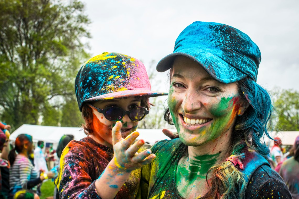 mother and child covered in paint