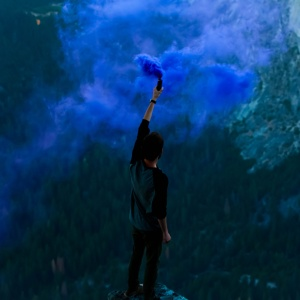 person with a bunch of blue smoke