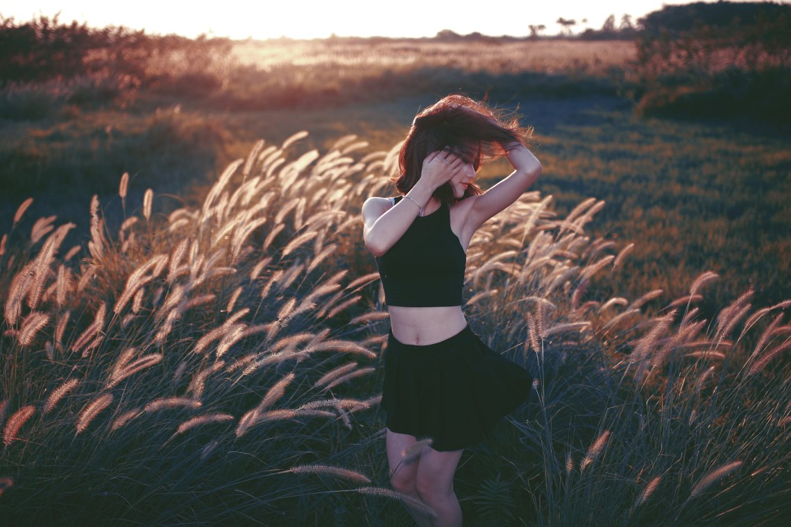 girl in a bunch of wheat