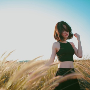 girl crop top and she's in a field