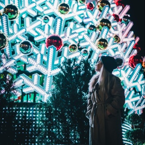 woman standing in front of christmas tree
