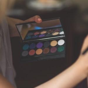 makeup artist working on a face