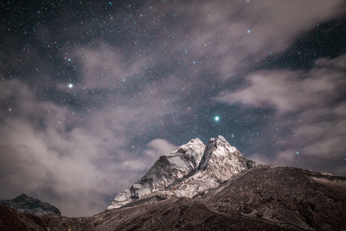 mountain with stars in the background