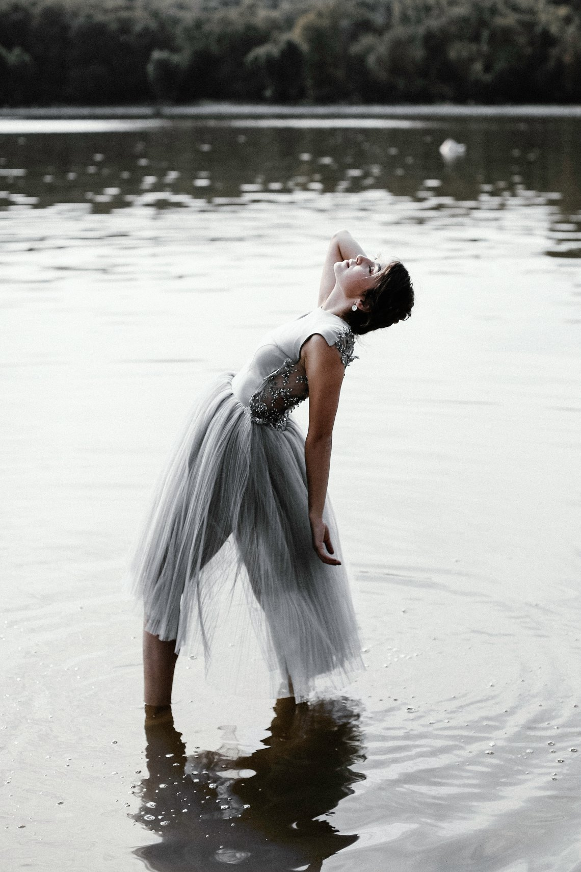 girl doing a backbend in water