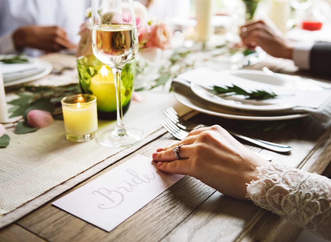 bride wearing diamond engagement ring