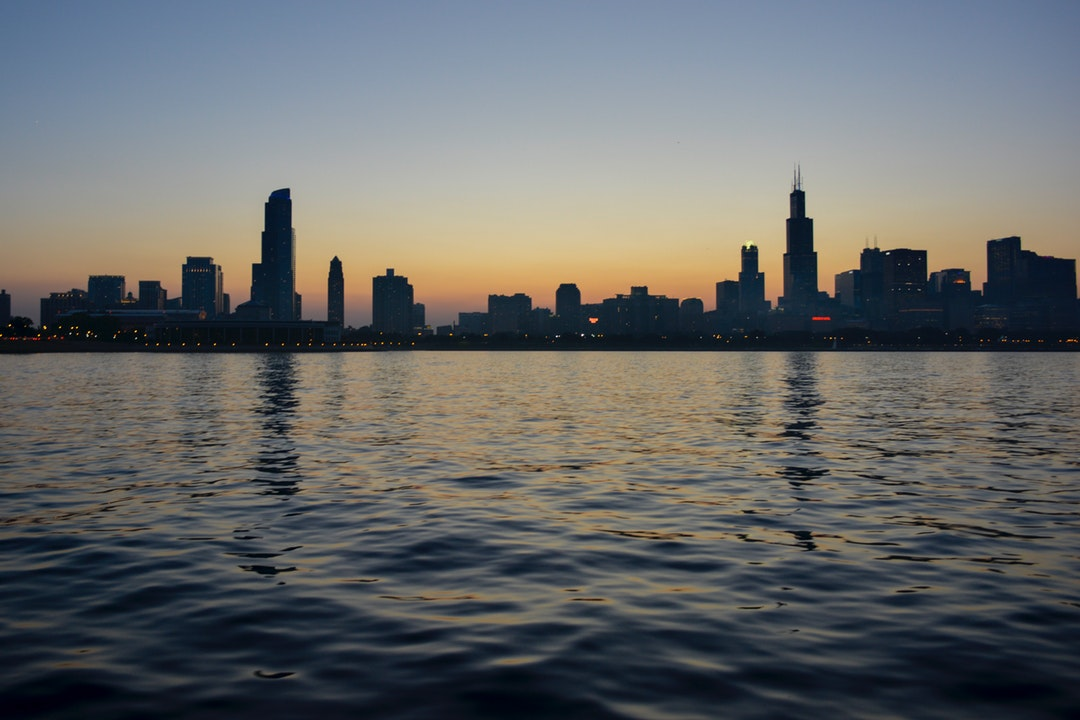 The skyline of Chicago seen from the Michigan Lake at sunset