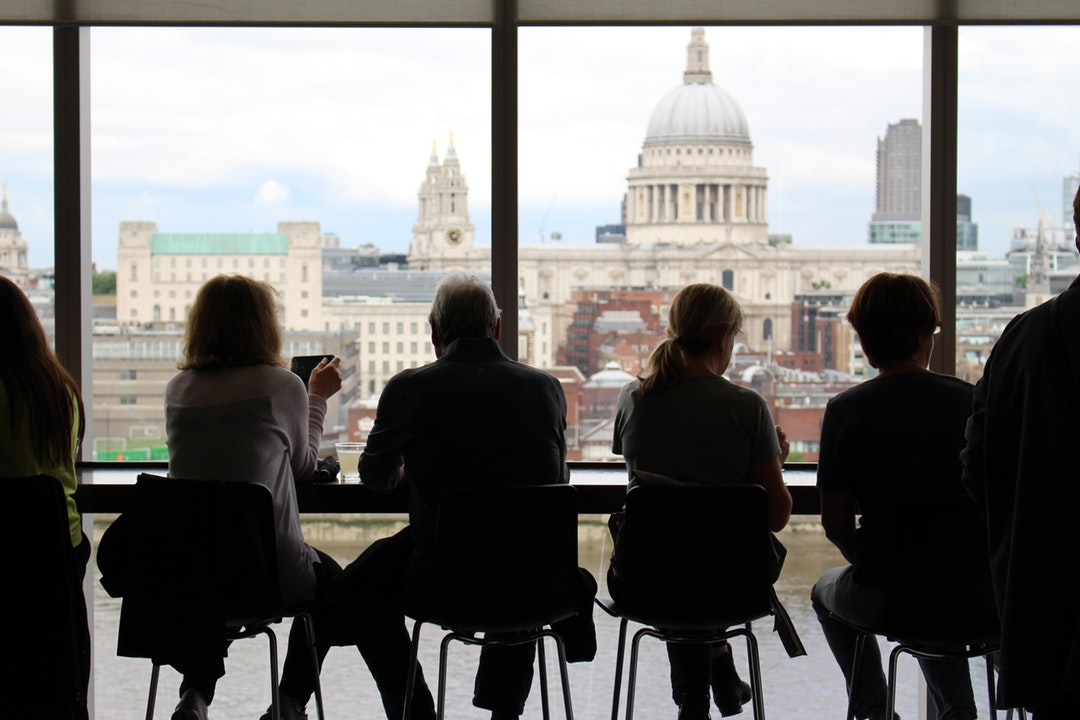 People sitting at a table at a café with a view on St. Paul's Cathedral in London