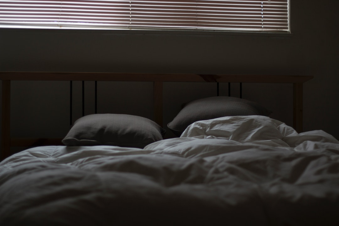 empty white and gray bed set
