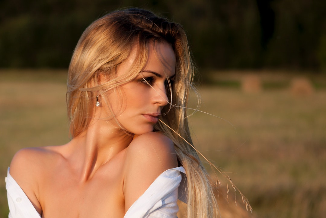 Woman wearing an off the shoulder shirt looking away