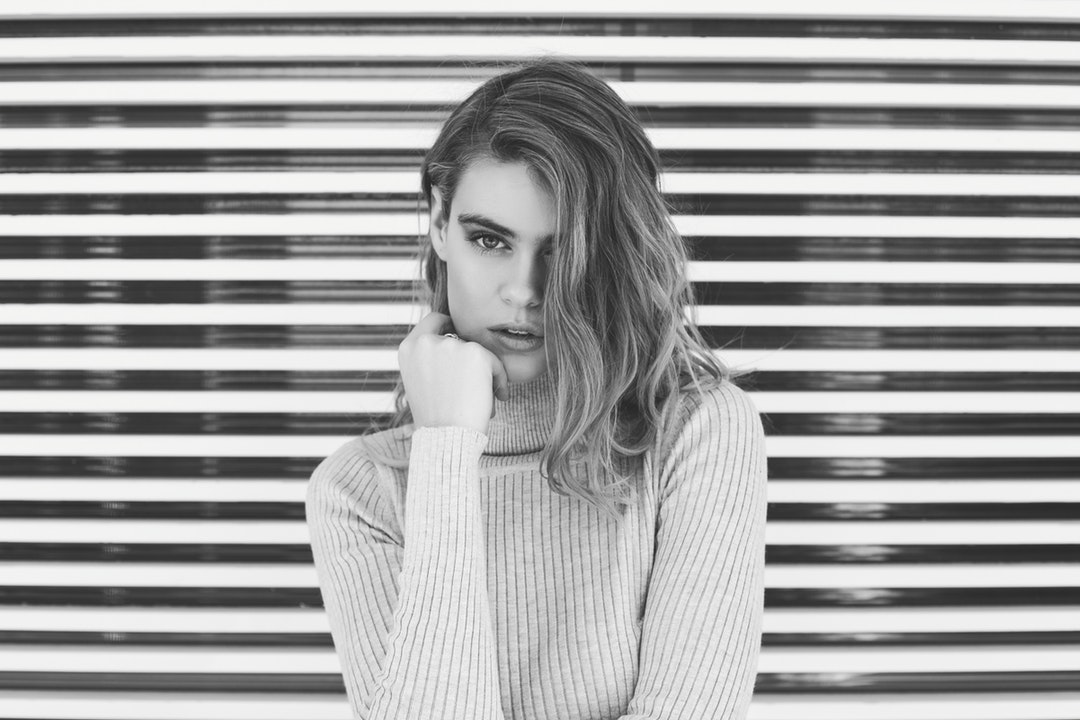 Black and white shot of attractive woman wearing turtleneck jumper in Tamarama