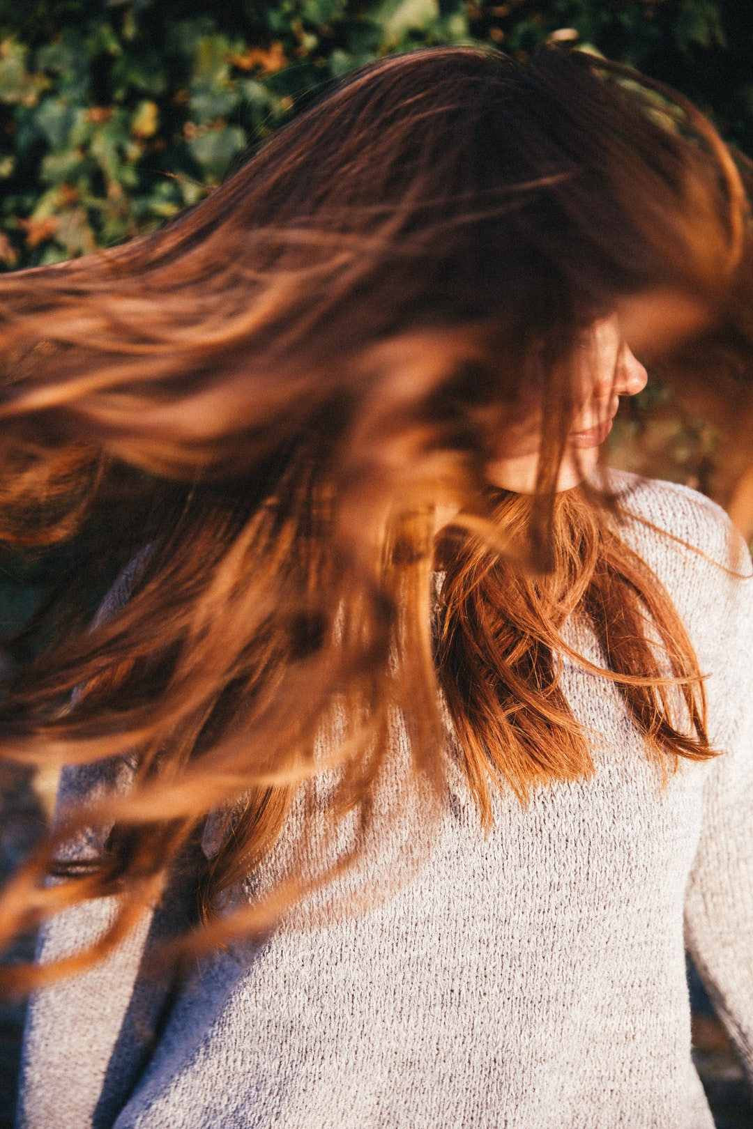 Woman shaking out her hair freely