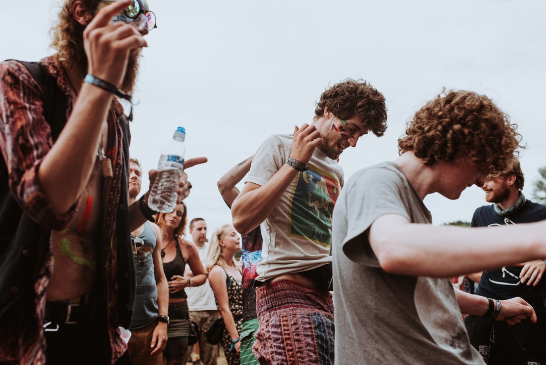 A group of young people enjoying themselves at a music festival