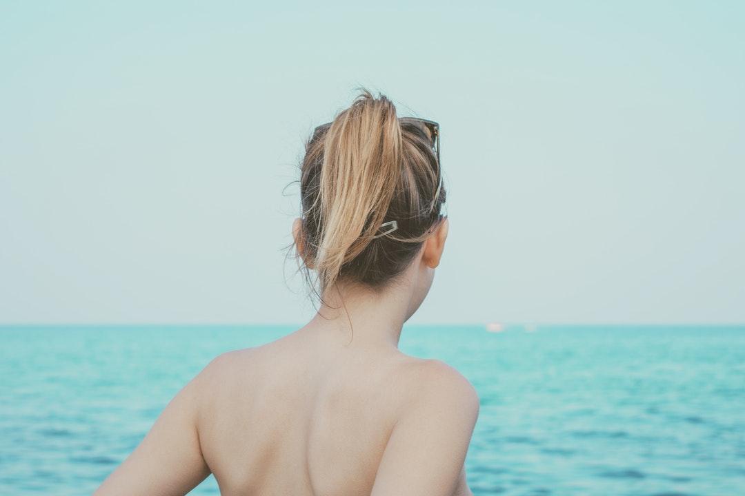 woman looking at sea at daytime