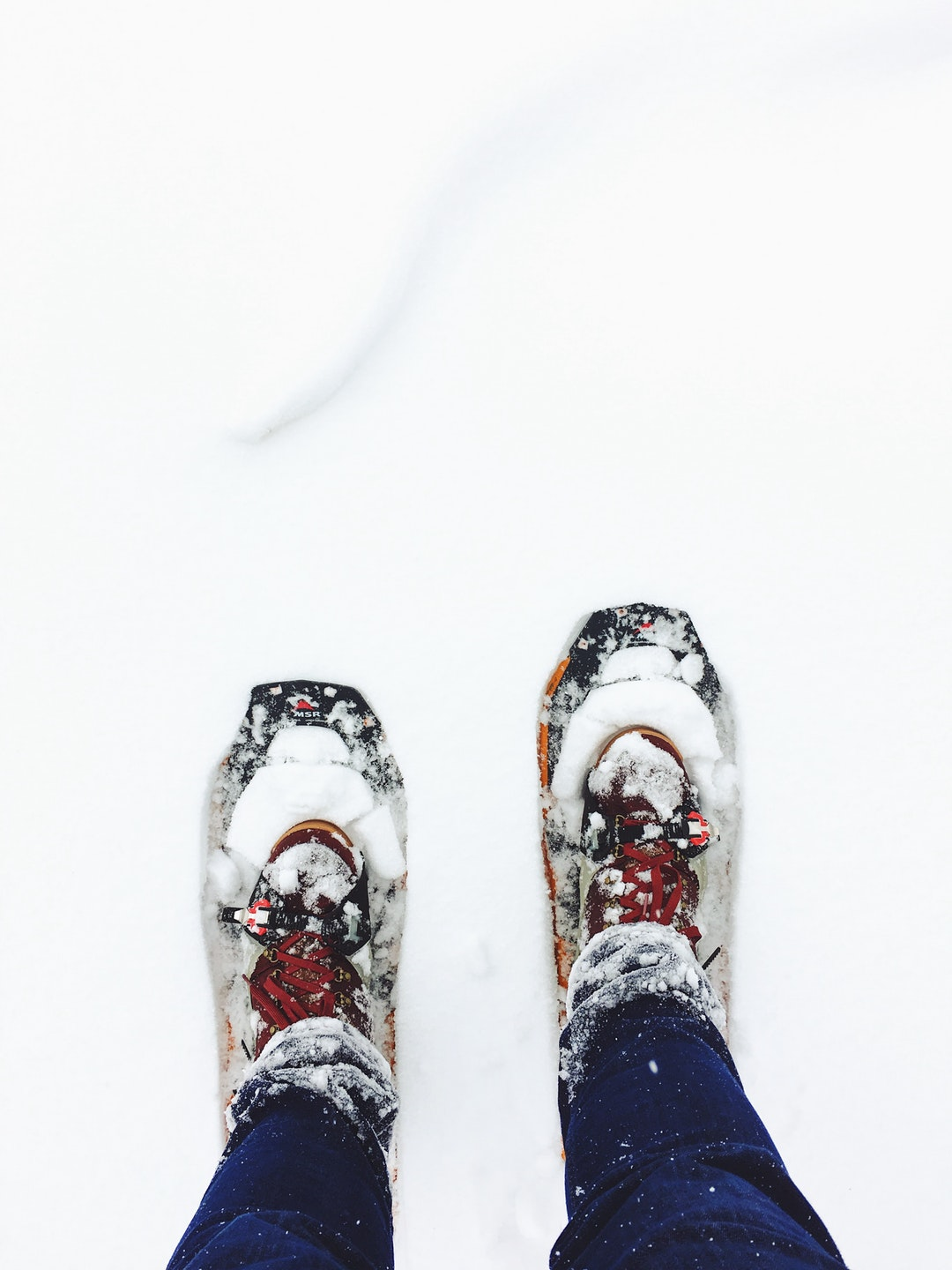 Staring down at a pair of winter shoes in the snow in Kamas, Utah