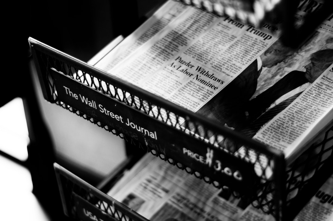 A black-and-white shot of newspapers in a store