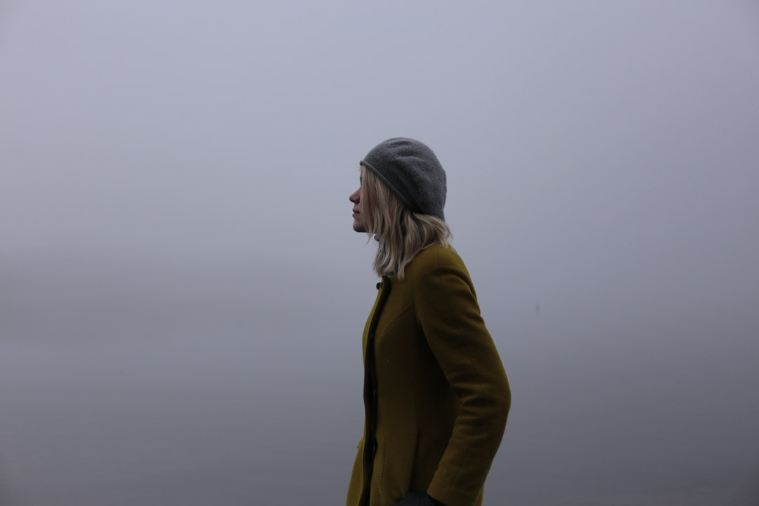 Profile of fashionable woman outside in the fog