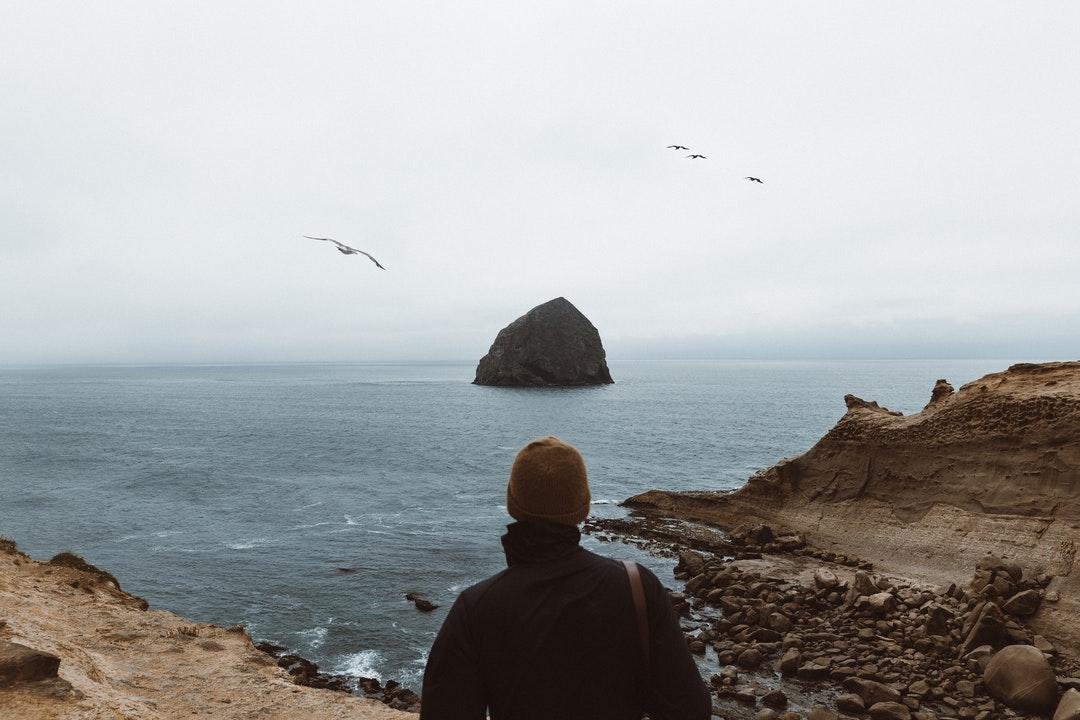 person wearing black jacket facing islet