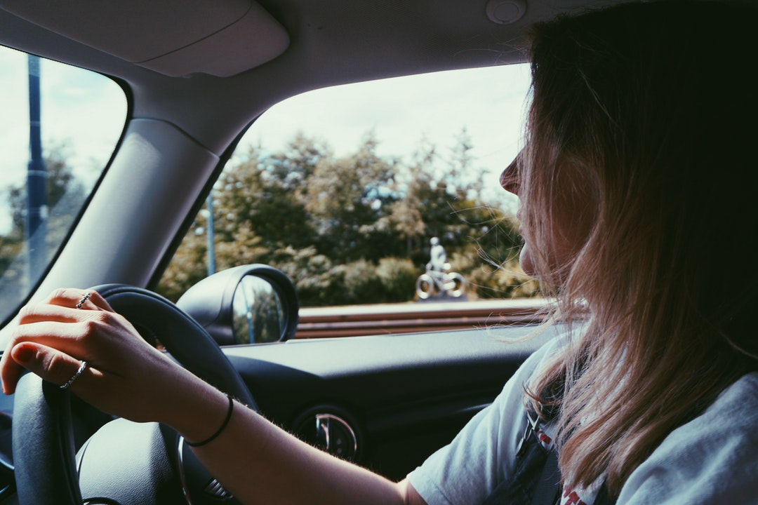 Woman concentrates on the road while driving