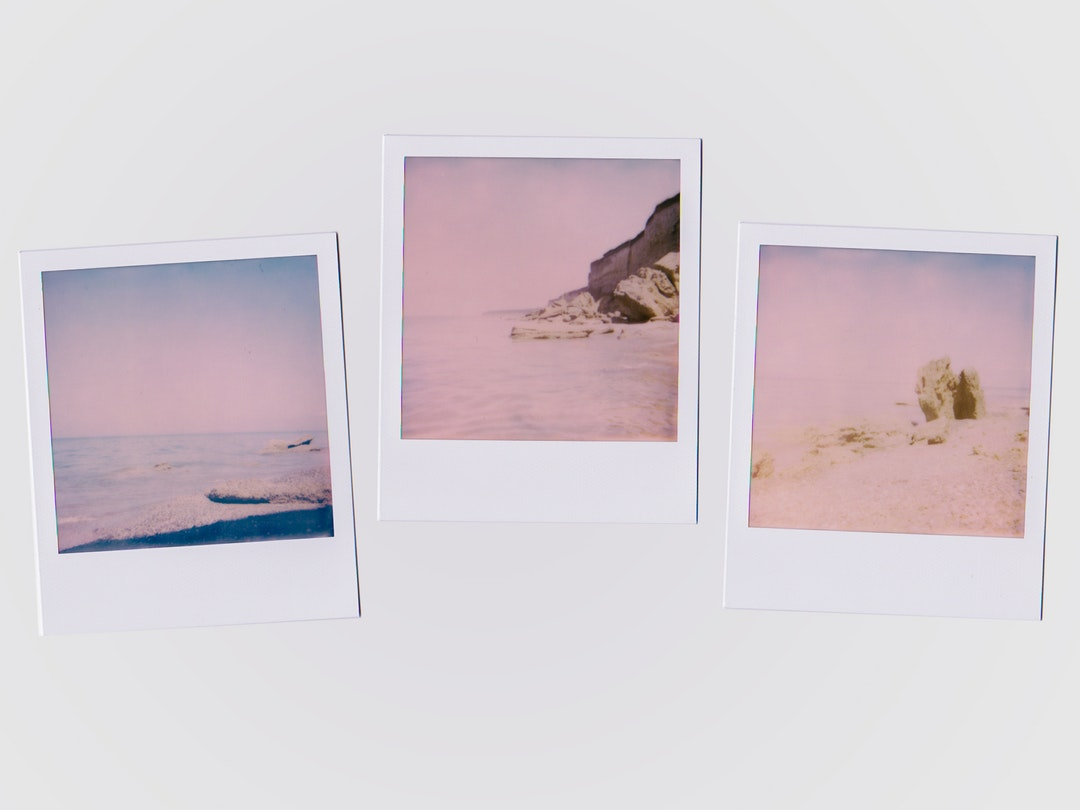 Three photographs of the ocean on a wall
