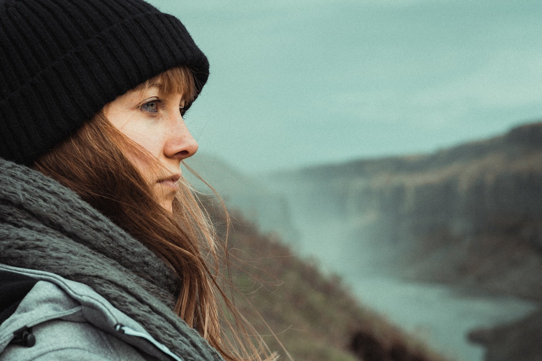 woman wearing black nit cap
