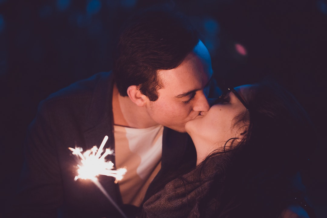 man and woman kissing eachther