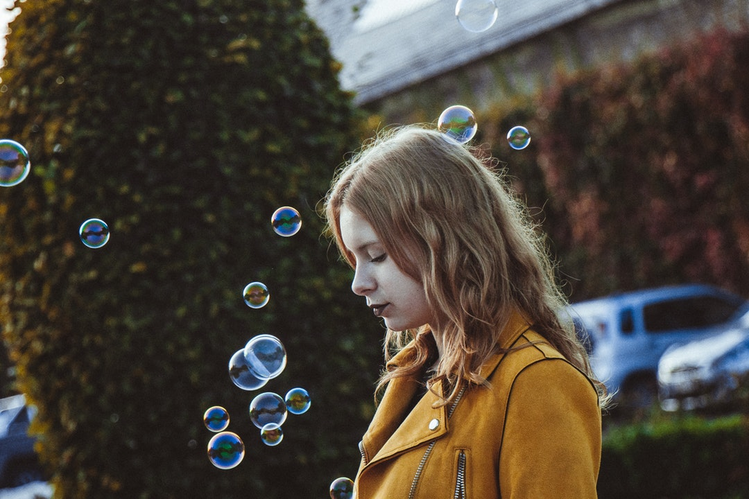 selective focus photography of woman with bubbles