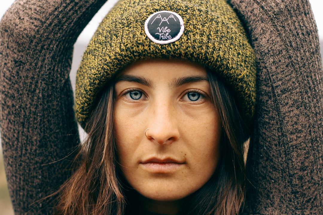 woman wearing green knit cap