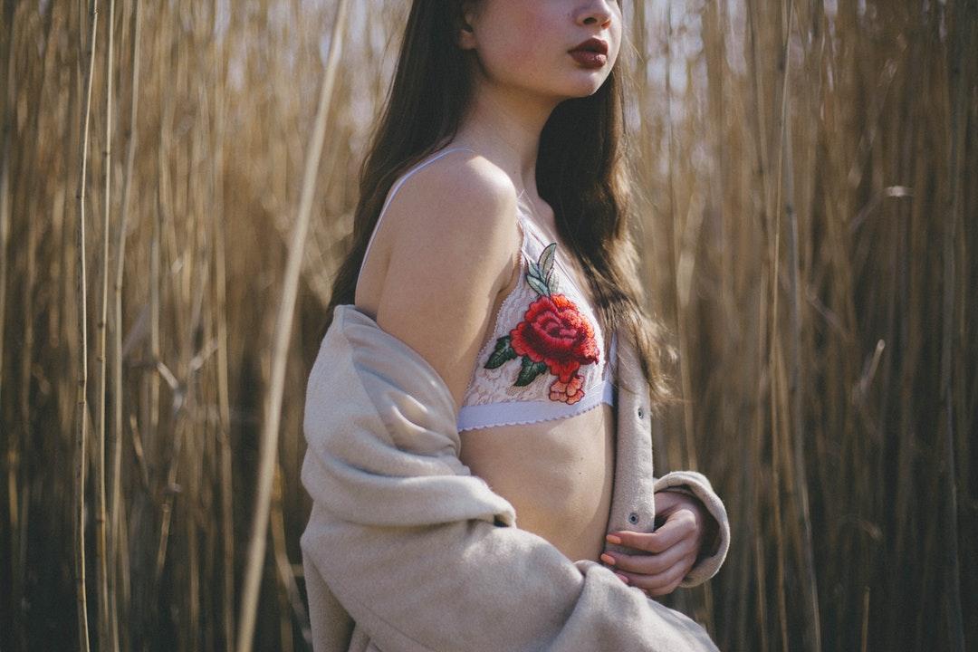 woman standing near wheat field