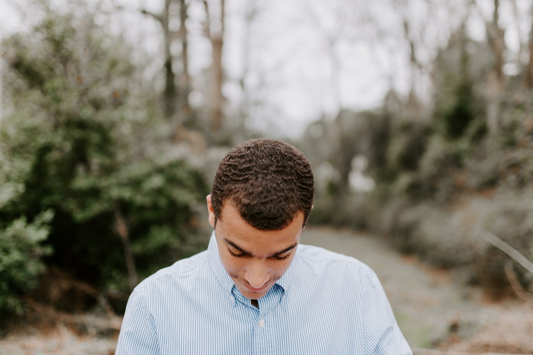 selective focus photography of man