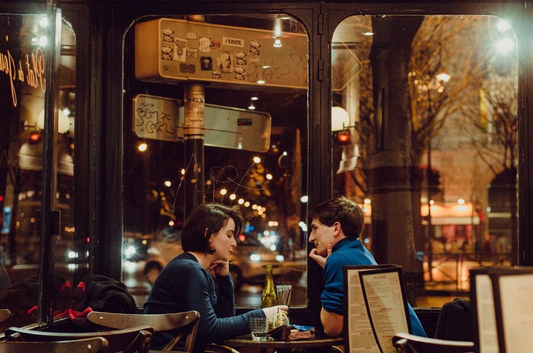 couple sitting near table inside cafe