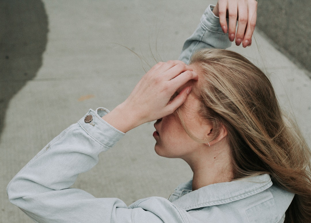 woman holding her forehead