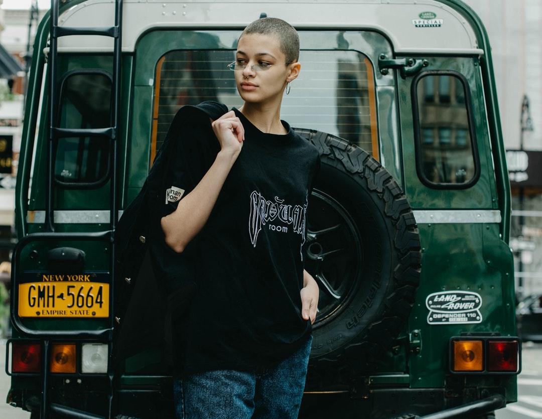 woman standing neat black vehicle