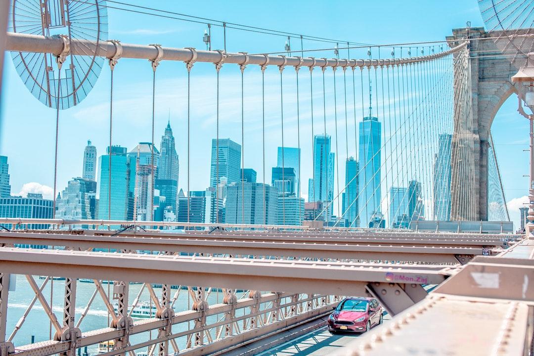 photo of vehicle passing through suspension bridge