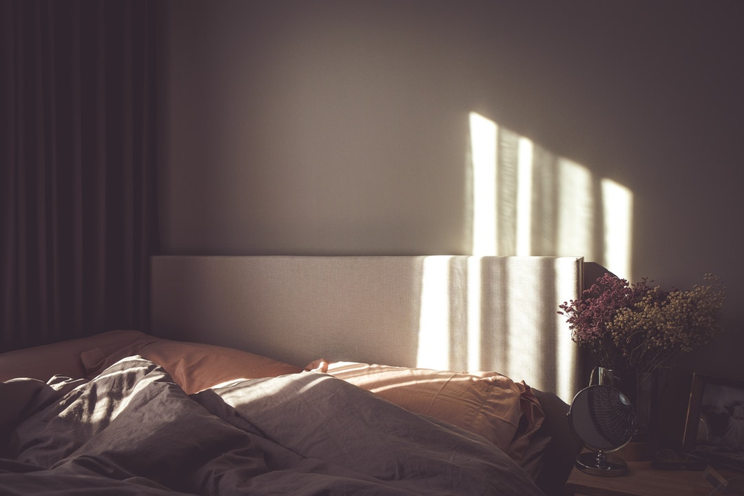 flowers in empty bedroom