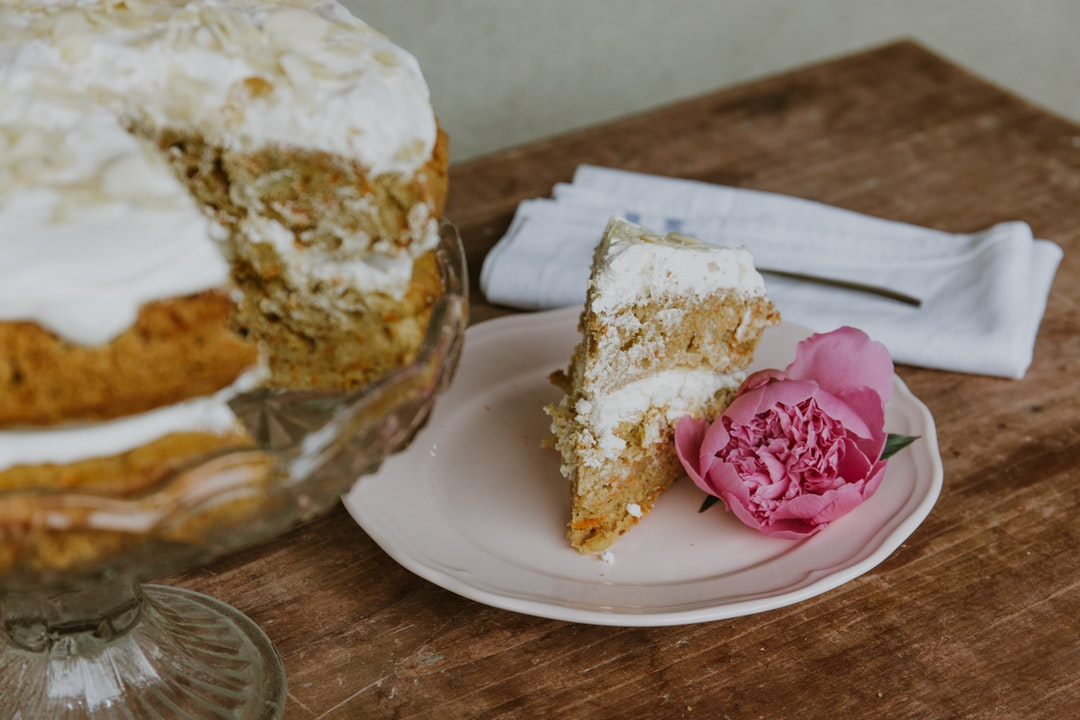 vanilla cake with rose on saucer