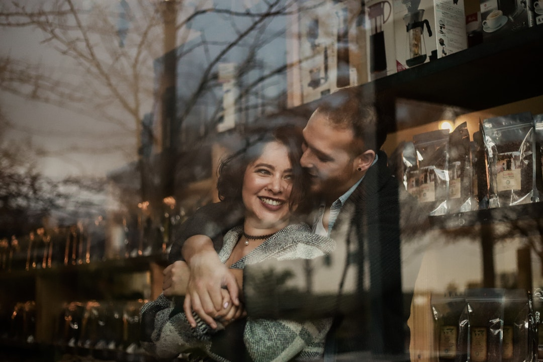 couple hugging inside house